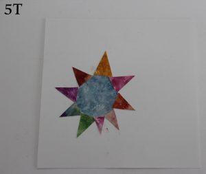 A multicoloured sun from a white backing paper