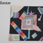 A series of water colour multicoloured shapes on a black backing piece of paper