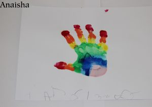 A hand painted using rainbow paint