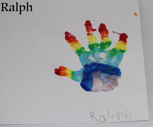 A rainbow painted hand print